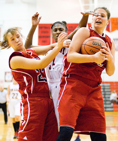New Albany guard Aaliyah Bell fights for a rebound during the Bulldogs' home game against Bedford North Lawrence on Tuesday. Staff photo by Christopher Fryer