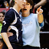 Providence head coach Terri Purichia talks to sophomore Taylor Wilson by the bench during their Class 2A state championship match against Wapahani at Worthen Arena in Muncie on Saturday. Wapahani won the match in four sets. Staff photo by Christopher Fryer