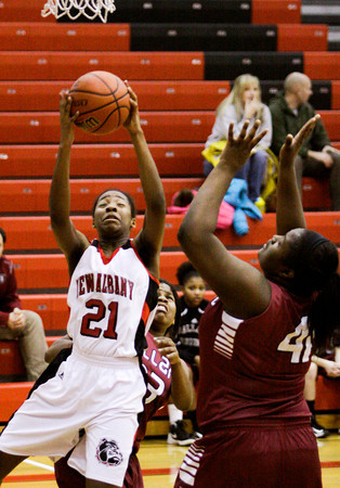New Albany forward Brianne Nixon catches a pass underneath the basket during their home game against Ballard on Thursday. New Albany lost the game, 60-51. Staff photo by Christopher Fryer