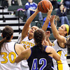Floyd Central senior Niki Bruno pulls down a rebound Wednesday night against Charlestown. Staff photo by C.E. Branham