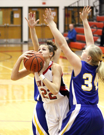 New Albany sophomore Lauren Camm splits the New Washington defense for a shot Tuesday night. Staff photo by C.E. Branham