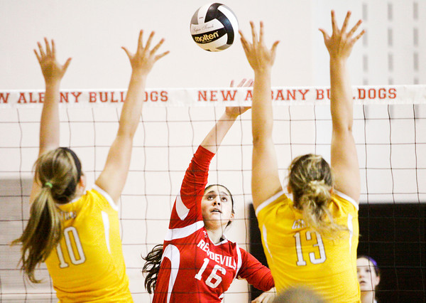 Jeffersonville's Mary Pat Geary goes up for a shot during their match against Evansville Central at the River City Invitational at New Albany on Saturday. Evansville Central won the match in three sets. Staff photo by Christopher Fryer
