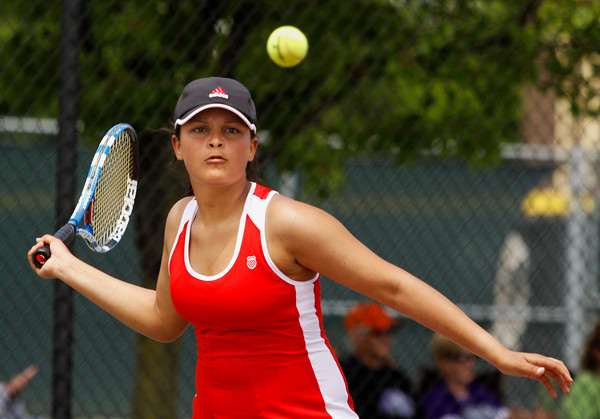 Jeffersonville High School junior Julianna Jenks rares back to return the ball to Columbus East High School freshman Megan Galle during their No. 2 singles match at Jeffersonville on Saturday afternoon. Galle won the match 6-1, 6-4. Staff photo by Christopher Fryer