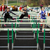 Floyd Central's Madison Kaiser competes in the 100-meter hurdles during the Floyd Central Girl's Invitational track meet on Friday. Staff photo by Christopher Fryer