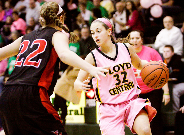 Floyd Central forward Abbie Engle moves the ball down court during the Highlanders' home game against New Albany on Saturday. New Albany won the game, 54-46. Staff photo by Christopher Fryer