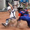 Jordyn Stengel beats the tag of Silver Creek catcher Lexy Kiper to score for Providence Friday night. Staff photo by C.E. Branham