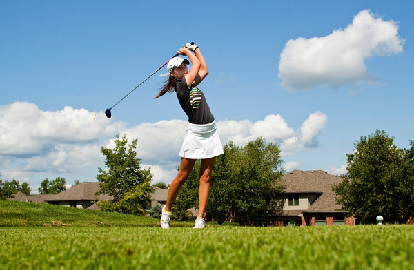 Floyd Central junior Eliza Hudson tees off on the 11th hole at Covered Bridge Golf Club during the 2012 Hoosier Hills Conference Golf Tournament in Sellersburg on Saturday. Staff photo by Christopher Fryer