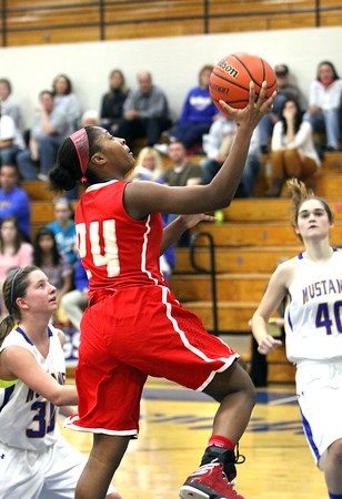 Jeffersonville junior Aureeshae Hines scores in transition at New Washington Thursday night. Staff photo by C.E. Branham