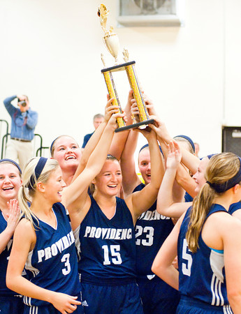 Providence celebrates its 63-37 victory over Henryville in the championship game of the Henryville Tipoff Tournament on Saturday. Staff photo by Christopher Fryer