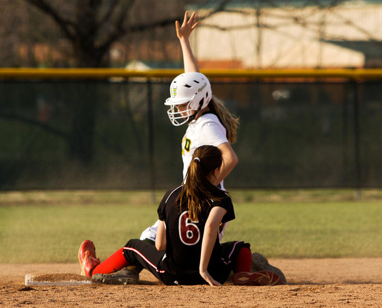Floyd Central freshman Regan Hadley is called safe at second base after New Albany sophomore Hannah Veit lost control of the ball during their game at Floyd Central on Tuesday. Floyd Central won the game, 2-1. Staff photo by Christopher Fryer