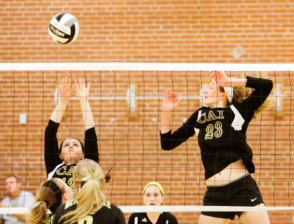 Christian Academy senior Hannah Staggers, left, and junior Krista Boesing attempt to block a shot during their match at Henryville on Tuesday. Staff photo by Christopher Fryer