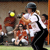 Henryville batter Erin Hairston lays down a bunt against <br /> Crawford County in the opening game of the 2A sectional Monday evening. Henryville won 8-7 in eight innings.  Staff photo by C.E. Branham