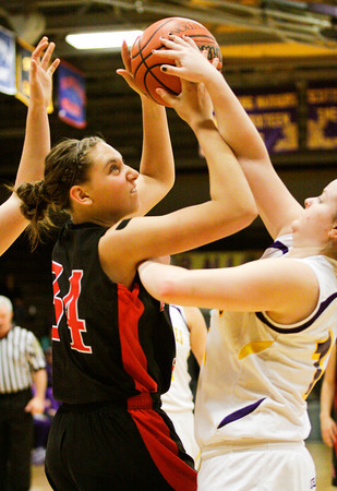 New Albany forward Claire Hirsch struggles to make a shot during their game at Scottsburg on Thursday. Staff photo by Christopher Fryer