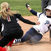 Providence junior Morgan Boone slides safely under the tag of New Albany shortstop Mady Bowman to steal third base. Staff photo by C.E. Branham