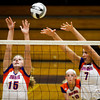 Silver Creek High School's Kaitlyn Ramser, left, and Kendra Kirchgessner attempt to block a shot during their match against Providence High School at Providence on Wednesday evening. Providence won the match in the first three sets. Staff photo by Christopher Fryer