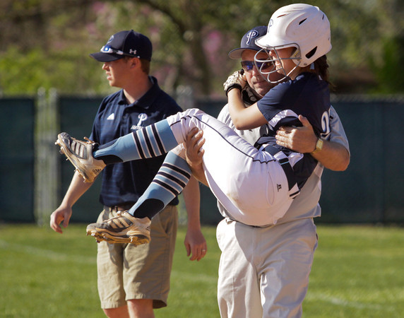 Providence senior Jordyn Stengel is carried off the field after being injured on a play at first base during the Pioneers' home game against Clarksville on Tuesday. Staff photo by Christopher Fryer