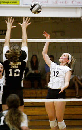 Providence sophomore Jacquie Hornung sends a shot over the net during their home match against Brownstown on Thursday. Providence won the match in three sets. Staff photo by Christopher Fryer