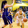 Henryville center Lesha Dallas drives to the basket during the Hornets' game against Paoli at the Eastern Sectional on Tuesday. Staff photo by Christopher Fryer