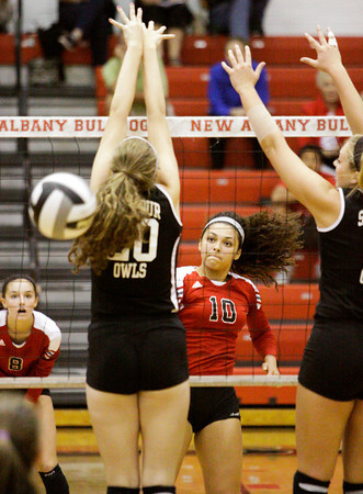 New Albany junior Audrey Donastorg takes a shot during their home match against Seymour on Thursday. Seymour took the match in three sets, 25-23, 25-23, 25-14. Staff photo by Christopher Fryer