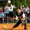 Henryville catcher Emily Stewart moves to the ball as Providence outfielder Jaclyn Endris scores their winning run in the seventh inning of their game at the Eastern High School sectional tournament on Monday. Providence won the game, 10-9. Staff photo by Christopher Fryer