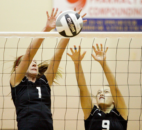 Borden senior Leslie Beatty, left, and sophomore Kristen Nestor block a shot during their match against Lanesville in the first round of the Class 1A Christian Academy of Indiana Volleyball Sectional tournament on Thursday. Staff photo by Christopher Fryer