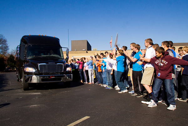 Providence students cheer for the varsity volleyball team as they leave the school following a send-off pep rally on Friday morning in Clarksville. The Pioneers will face Hammond Bishop Noll in the Class 2A State Championship in Muncie this afternoon. Staff photo by Christopher Fryer