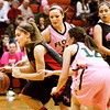New Albany guard Tanner Marcum drives the ball down court during their home game against Floyd Central on Saturday. New Albany won the game in double overtime, 69-64. Staff photo by Christopher Fryer