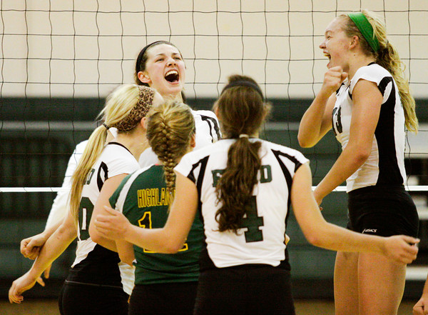 Floyd Central celebrates after winning the third game of their home match against New Albany on Thursday. Staff photo by Christopher Fryer