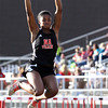 New Albany sophomore Courtney Palmer in the long jump finals of the Hoosier Hills Conference track and field meet Tuesday. Staff photo by C.E. Branham