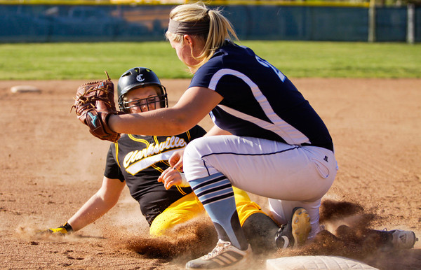 Clarksville's Katie Wingler slides safely into third base off of a triple during the Generals' game at Providence on Tuesday. Staff photo by Christopher Fryer
