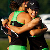 Floyd Central High School juniors Whitney Batliner, left, and Katherine Dauby embrace after defeating Jeffersonville High School juniors Morgan Reilly and Macy Lancaster during their No. 1 doubles match at the Indiana High School Athletic Association Girl's Tennis Regional tournament at Floyd Central on Tuesday evening. Batliner and Dauby won the match in three sets, 7-5, 6-3 and 3-6. Staff photo by Christopher Fryer