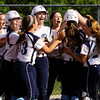 Providence freshman Marlee Karem is congratulated by her teammates after hitting a home run during their game against Eastern in the championship round of the Eastern sectional tournament on Thursday. Providence won the game in five innings, 19-2. Staff photo by Christopher Fryer