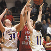 New Washington players Caroline Ricks (34) and Courtney Amick (11) battle with Borden senior Allison Bishop for a rebound.  Staff photo by C.E. Branham