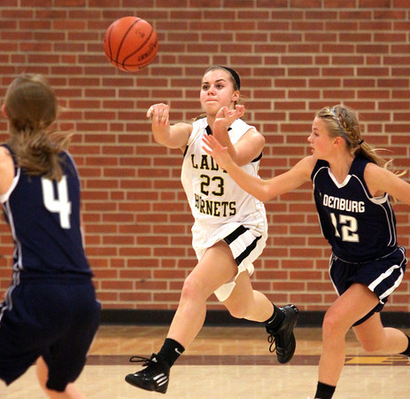 Henryville guard Emily Hollis passes up court against Oldenburg Academy in the championship game of the Henryville Tipoff Tournament. Staff photo by C.E. Branham