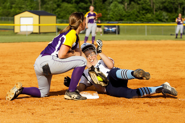 Providence sophomore Karly Baumann slides safely into third base on a two run RBI triple during their game against Eastern in the championship round of the Eastern sectional tournament on Thursday. Providence won the game in five innings, 19-2. Staff photo by Christopher Fryer