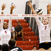 New Albany junior Kelsey Guess, left, and senior Catlin Lily attempt to block a shot during their home match against Brownstown Central on Thursday. Staff photo by Christopher Fryer