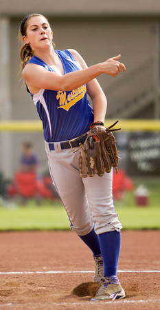 New Washington senior Whitney Morris pitches during their game against Lanesville in the Lanesville sectional tournament on Tuesday. Lanesville won the game, 1-0. Staff photo by Christopher Fryer