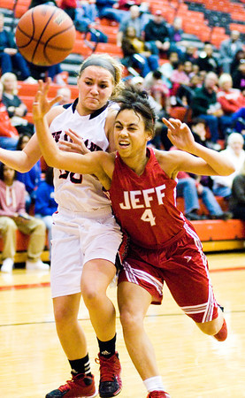 Jeffersonville guard Chelsea Lewis knocks the ball away from New Albany guard Brittany Knight during their game at New Albany on Friday. Staff photo by Christopher Fryer