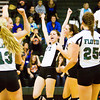 Floyd Central celebrates their victory over Castle in the Floyd Central Regional on Tuesday. The Highlanders took the match in four games, 21-25, 25-15, 25-16, 25-21. Staff photo by Christopher Fryer