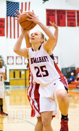 New Albany forward Ashley Lyninger goes up for a shot during the Bulldogs' 39-33 loss to Madison at home on Thursday. Staff photo by Christopher Fryer