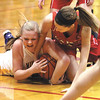 New Washington sophomore Caroline Ricks and Borden sophomore Abby Ellis tangle for a loose ball.  Staff photo by C.E. Branham
