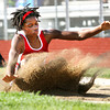 Jeffersonville freshman Candea Smith splashes into the pit in the long jump at the IHSAA Track and Field sectional Tuesday evening. Staff photo by C.E. Branham