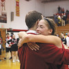 Borden senior Allison Rademacher hugs her coach and father Terry Rademacher after the Lady Braves beat New Washington 45-34 to capture the 1A sectional title.  Staff photo by C.E. Branham