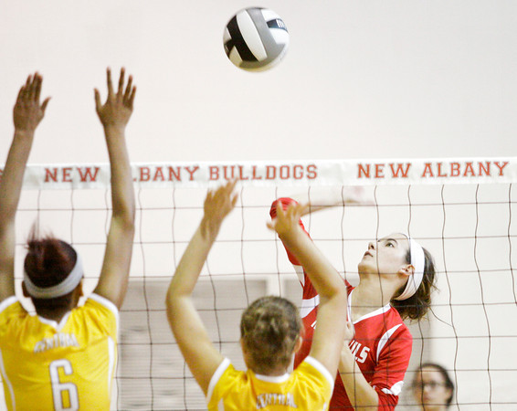 Jeffersonville's Hannah Samuel goes up for a shot during their match against Evansville Central at the River City Invitational at New Albany on Saturday. Evansville Central won the match in three sets. Staff photo by Christopher Fryer