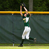 Floyd Central High School outfielder Kallie Krammes catches a fly ball in left field during their game against Bedford North Lawrence High School in the Hoosier Hills Conference Softball Tournament at Floyd Central on Friday night. Floyd Central won the game in extra innings, 2-1. Staff photo by Christopher Fryer