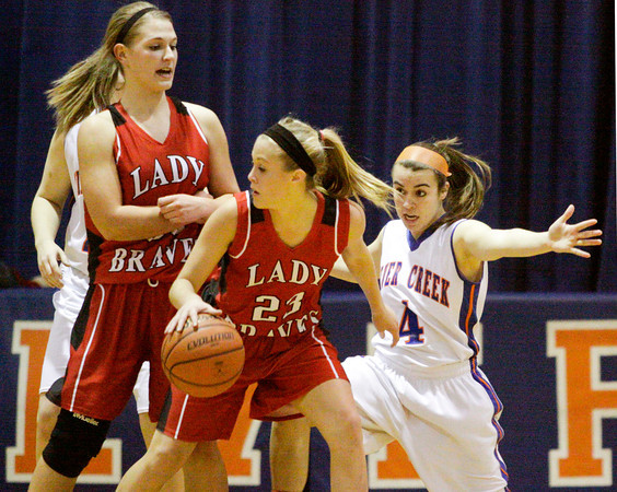 Silver Creek's Brooke Barnett covers Borden's Shelby Kirchgessner, center, during their game at Silver Creek on Thursday. Staff photo by Christopher Fryer