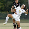 Floyd Central forward Lauren Wyatt and New Albany defender Ryan Milam fight for control of the ball during their game in the Indiana High School Athletic Association Girls Soccer Sectional at Floyd Central on Thursday. New Albany won the game, 3-2, after overtime play and a shoot out. Staff photo by Christopher Fryer