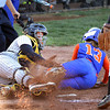 Silver Creek Lady Dragon Tiphany Harper scores as Clarksville catcher Kiersten Hall lost the ball Thursday at Clarksville. Staff photo by C.E. Branham
