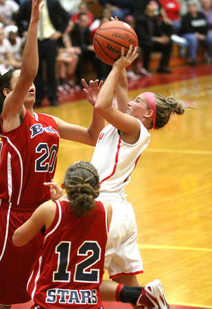 Jeff senior Nichole Midgett attempts a shot in the lane against Bedford North Lawrence Saturday night. Staff photo by C.E. Branham