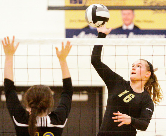 Henryville junior Kerri Cochran goes up for a shot during their home match against Christian Academy on Tuesday. Staff photo by Christopher Fryer